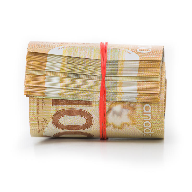 kanadensiska dollar rulle royaltyfri bild