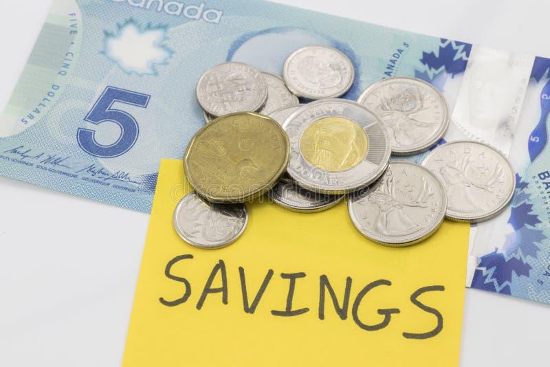 Kanadensiska pengar med en anmärkning som säger besparingar på den fotografering för bildbyråer