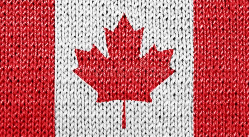 Kanadische Staatsflagge auf gestricktem Hintergrund stockfotografie