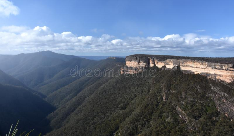 Kanangra Walls in Kanangra-Boyd National Park. Are spectacular, orange and grey sandstone cliffs towering above the Kanangra Creek gorge stock photography