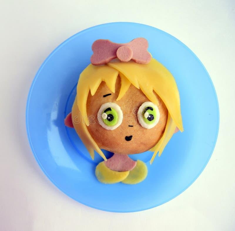 Kanapka w postaci dziewczyny ` s głowy obraz stock