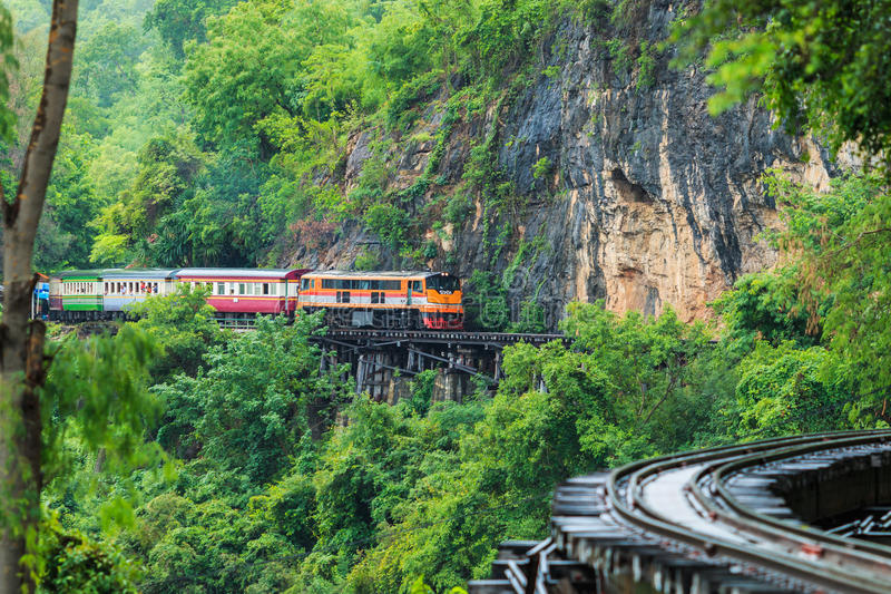 KANCHANABURI PROVINCE, THAILAND - June 18: Train rides besides the mountain royalty free stock photo