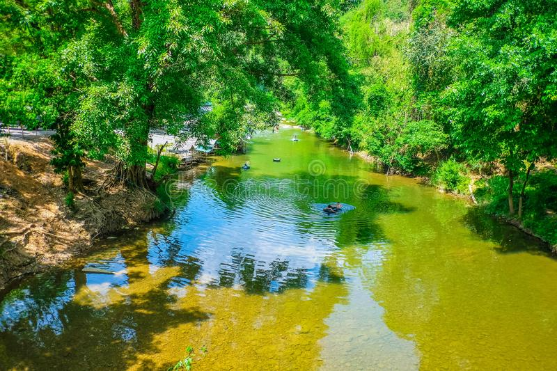 Kanchanaburi/Thailand - April 17 2018 :Beautiful river on countryside Thailand,Beautiful Nature of countryside thailand,People Re. Lax in the beautiful lake stock photo