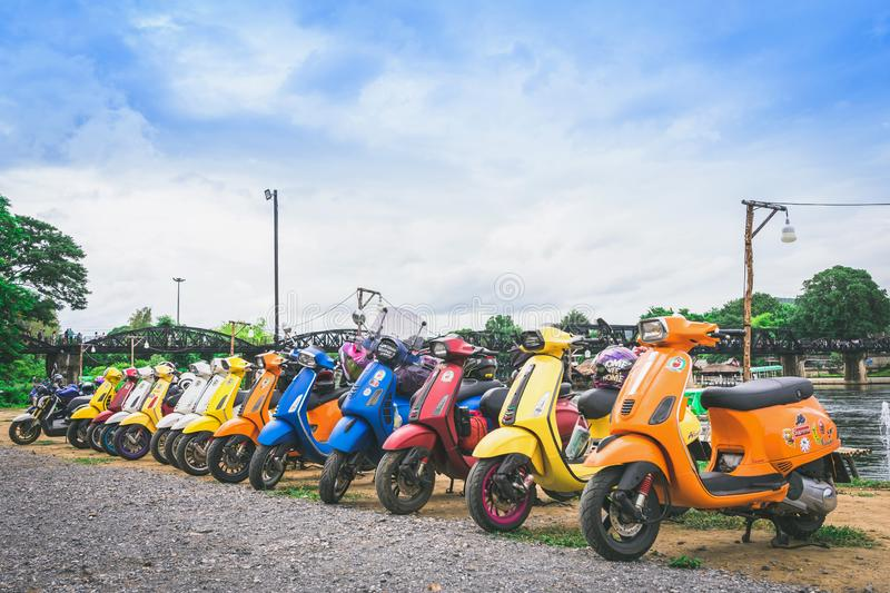 KANCHANABURI, THAILAND - August 4, 2019 : Vespa gang were parking in the line for meeting and gethering after touring together at stock photography
