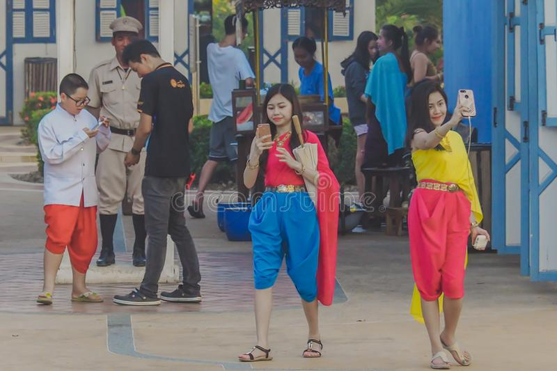 KANCHANABURI,THAILAND-DECEMBER 10 : Unidentified tourists in Thai costumes take photos of themselves on December. 10,2017 at Mallika City Mallika City or Muang royalty free stock image