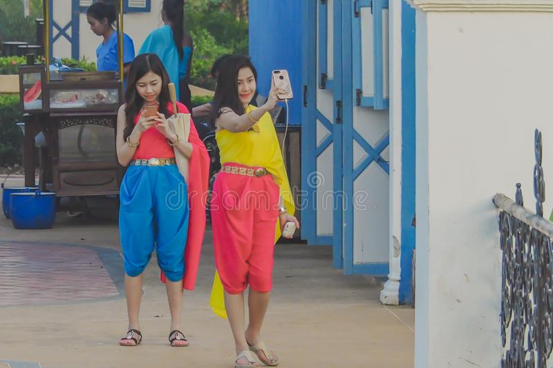 KANCHANABURI,THAILAND-DECEMBER 10 : Unidentified tourists in Thai costumes take photos of themselves on December. 10,2017 at Mallika City Mallika City or Muang royalty free stock photography