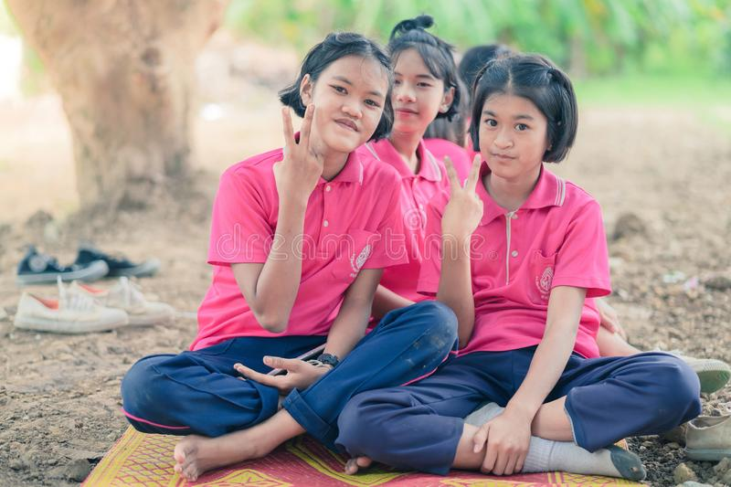 KANCHANABURI THAILAND - JULY 18 : Unidentified Students relax a stock photo