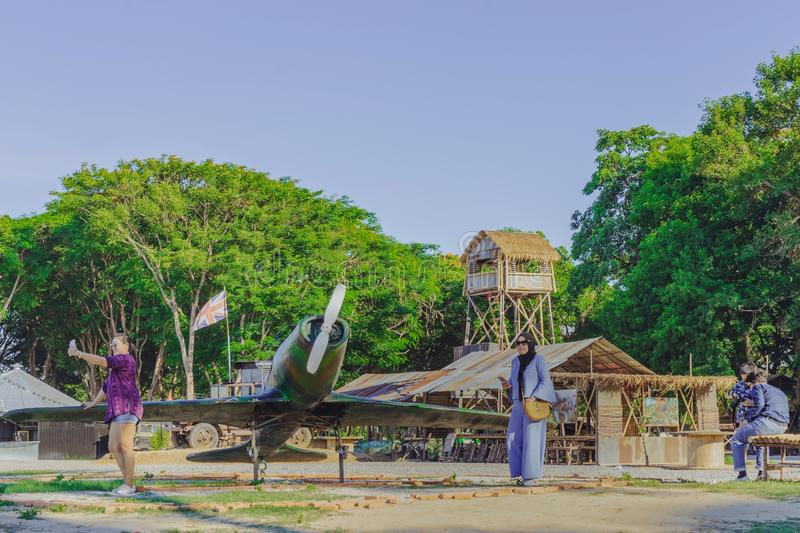 KANCHANABURI THAILAND-JULY 16,2019 : Unidentified tourists come to visit and take pictures at  World War ll Bridge Project near stock photos