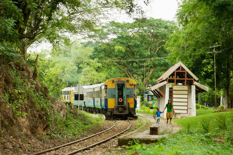 Vintage train stops at the station of the Death railway in Kanchanaburi, Thailand. stock photography