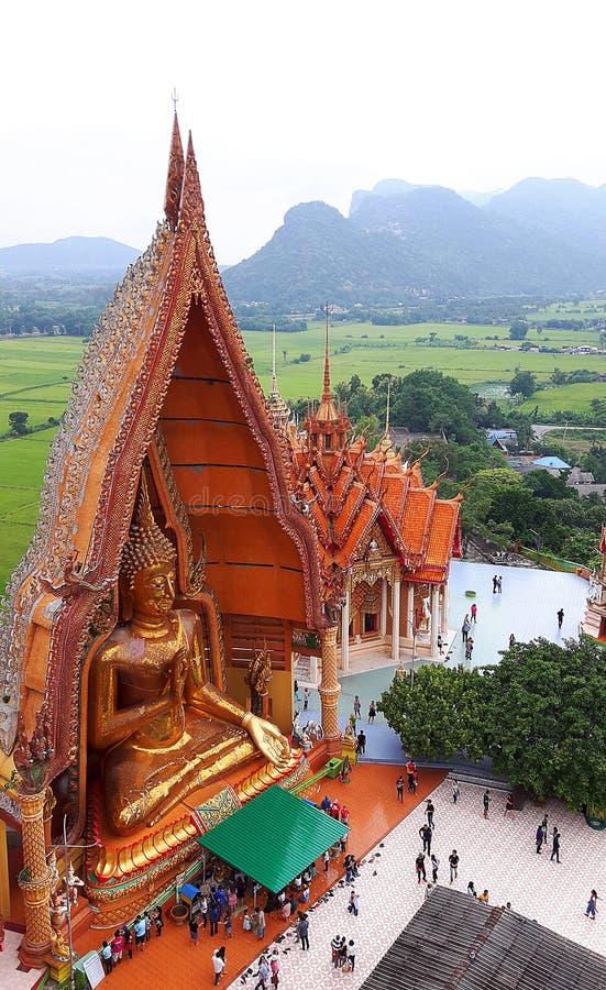 KANCHANABURI, THAILAND - NOVEMBER 7, 2015: Big golden Buddha from top view at Wat Tham Suea royalty free stock images