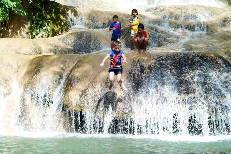 Kanchanaburi, Thailand:October 31, 2019 - Group of children play happily at water fall  in Thailand. Lifestyle of children royalty free stock images