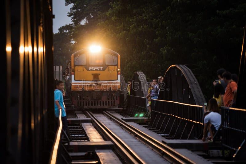 Tourist see train on river kwai bridge royalty free stock image