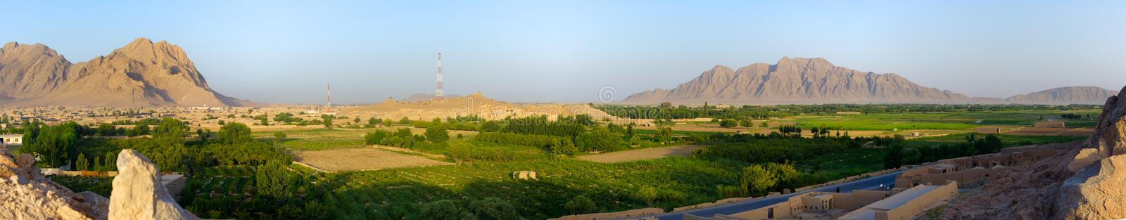 Kandahar, Afghanistan Panorama. A panoramic view of Kandahar Province, Afghanistan. This view looks out over the fertile farmland running along the Argendap stock image