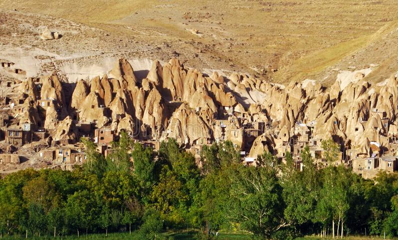 Kandovan village. Kandovan or Kandowan is a living village built into rocks. This village exemplifies man made cliff dwellings which are still inhabited stock photography