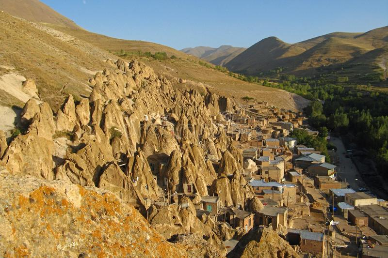 Kandovan village. Kandovan or Kandowan is a living village built into rocks. This village exemplifies man made cliff dwellings which are still inhabited stock photo