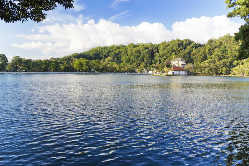 Kandy Lake, Sri Lanka. Image of Kandy Lake and the Temple of Tooth together with the Royal Palace, Sri Lanka. These are UNESCO's World Heritage sites. The Temple stock image