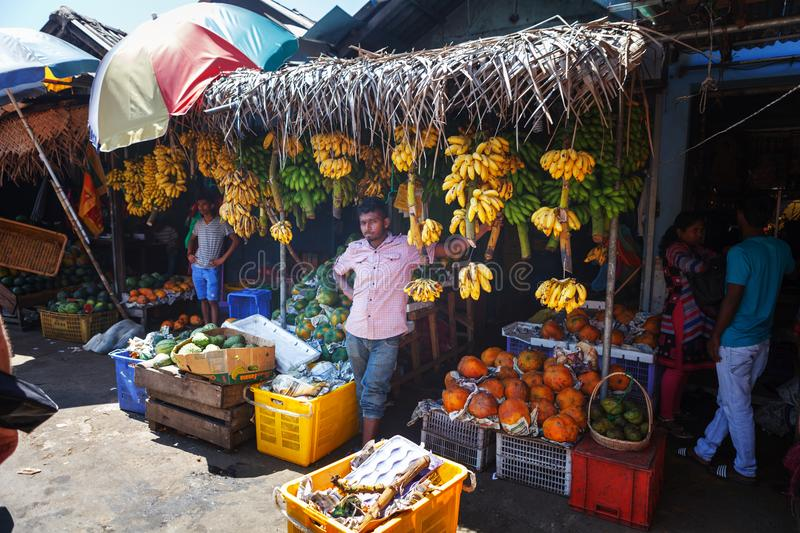 Sellers in street shop sell fresh fruits bananas, papaya and vegetables. Traditional Asian local market royalty free stock photos