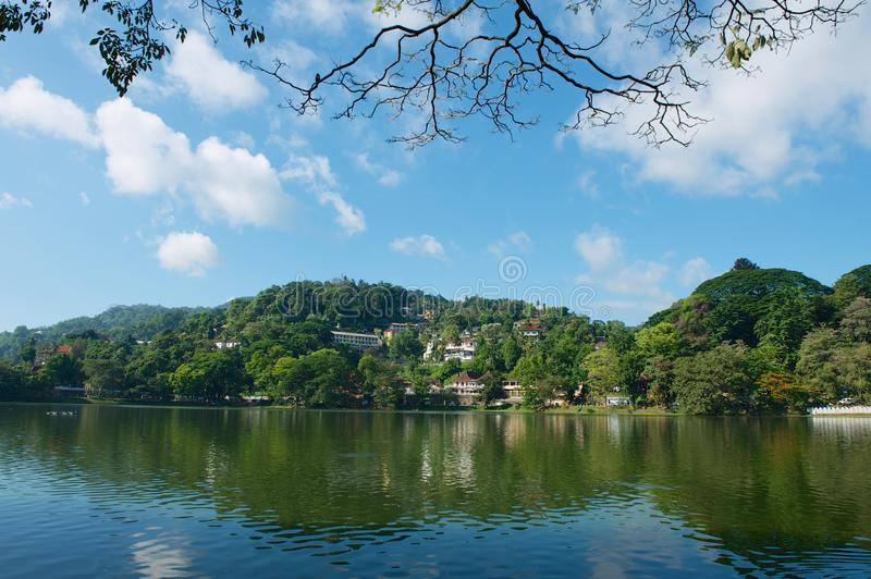View to the buildings with beautiful landscape at the bank of reservoir in Kandy, Sri Lanka. royalty free stock photography