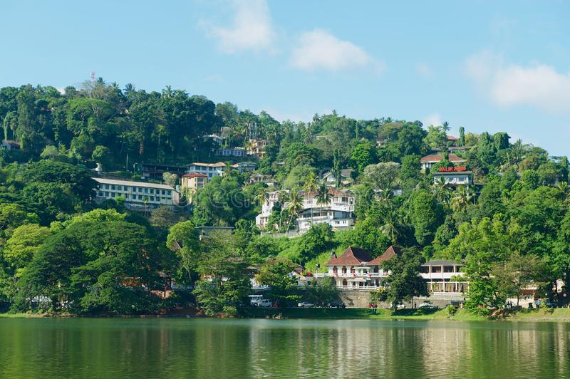 View to the buildings with beautiful landscape at the bank of reservoir in Kandy, Sri Lanka. royalty free stock photo