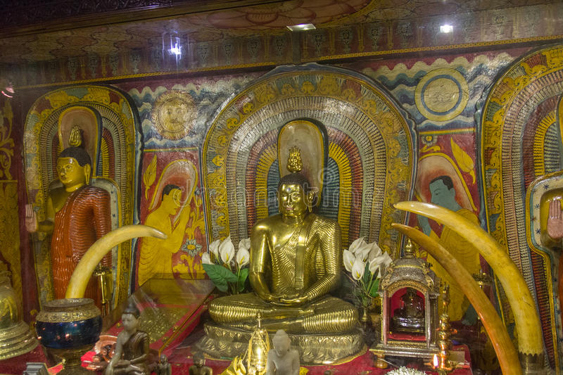 Kandy temple. KANDY, SRI LANKA: Buddha statue in temple of the Sacred Tooth Relic stock image