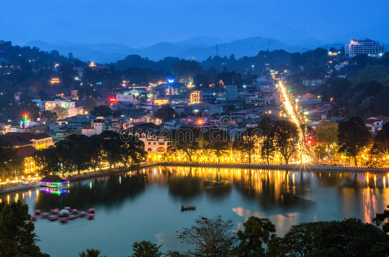 Kandy Town at dusk. Temple of the Sacred Tooth, Sri Dalada Maligawa by Kandy Lake, Kandy. During annual Perahera festival. Kandy was designated a UNESCO World royalty free stock photography