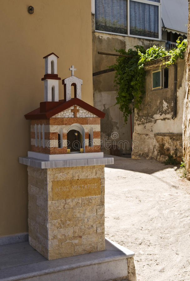 Kandylakia, a Greek Mini-Chapel. Kandylakia is a tiny chapel built by the side of the road or in a city as a public praying place. It is a shrine built in the stock image