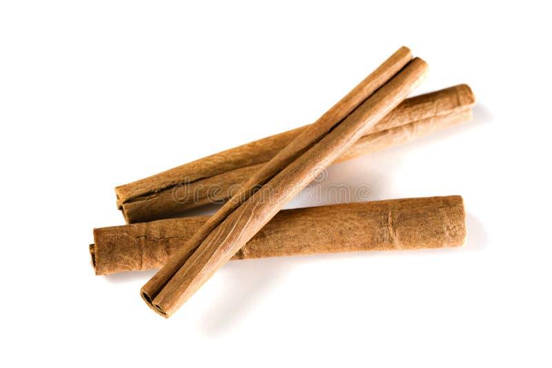 kanelbruna isolerade quillsserier kryddar white royaltyfri fotografi