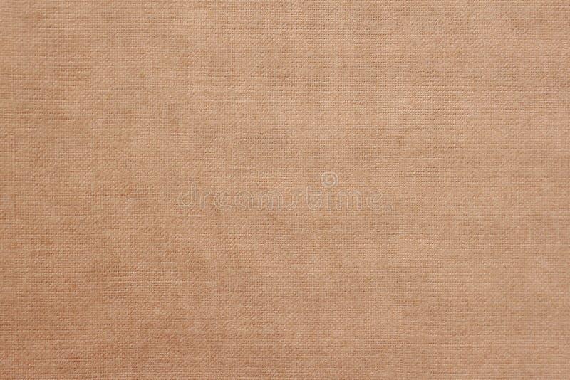 Kanfas tygbakgrund med synlig textur, tryckdesignbeståndsdelar Closeup av varm mjuk kaffefärgjute, textur arkivbild