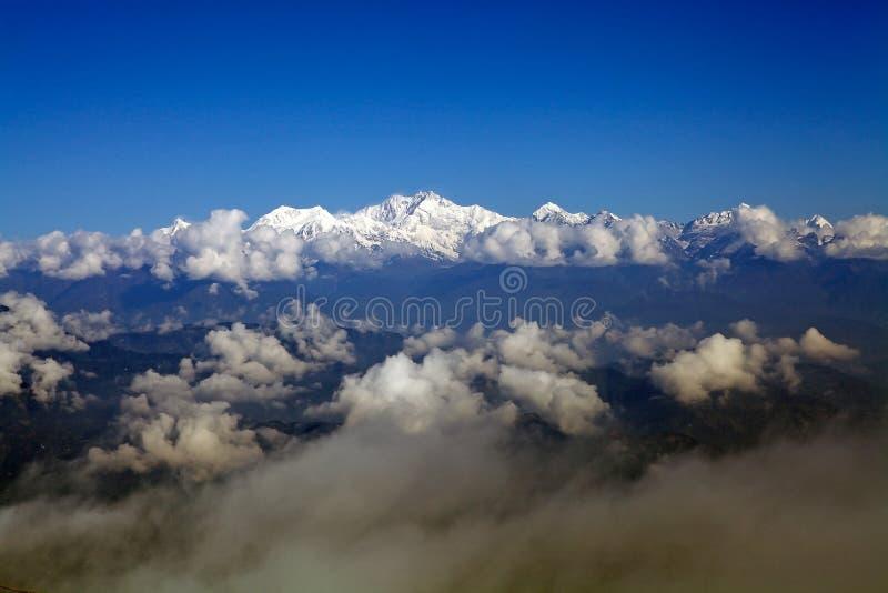 Kangchenjunga mountain, Sikkim, India. Kangchenjunga peak view with clouds, Himalaya mountain range, Sikkim, India. Kangchenjunga is the third highest mountain stock images