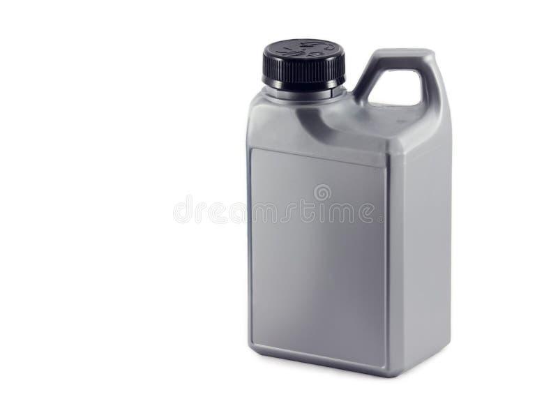 Kanister med olja. auto delar royaltyfri foto