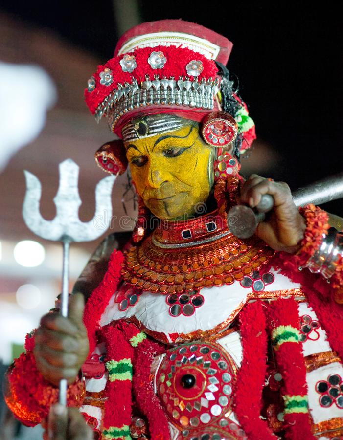 Theyyam Ceremony in Kerala state, South India. KANNUR, INDIA - JANUARY 15, 2016: Indian man conducts Theyyam ceremony. Theyyam is a ritualistic folk art form of stock image