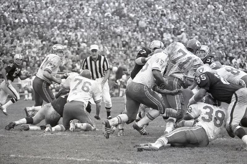 Kansas City Chiefs vs the Oakland Raiders 1969. Image taken from a B&W negative royalty free stock images