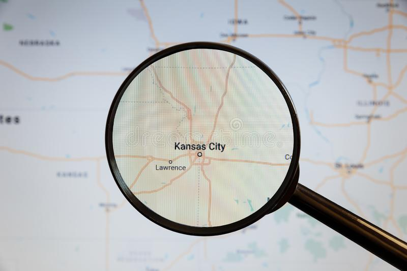 Kansas City, United States. Political map. The city on the monitor screen through a magnifying glass royalty free stock image