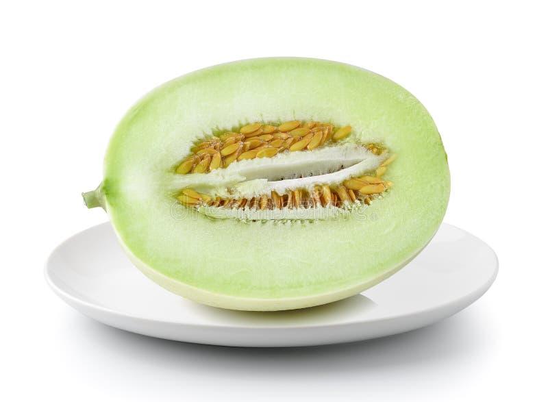 Kantaloepmeloen in plaat op een witte achtergrond wordt geïsoleerd die royalty-vrije stock fotografie