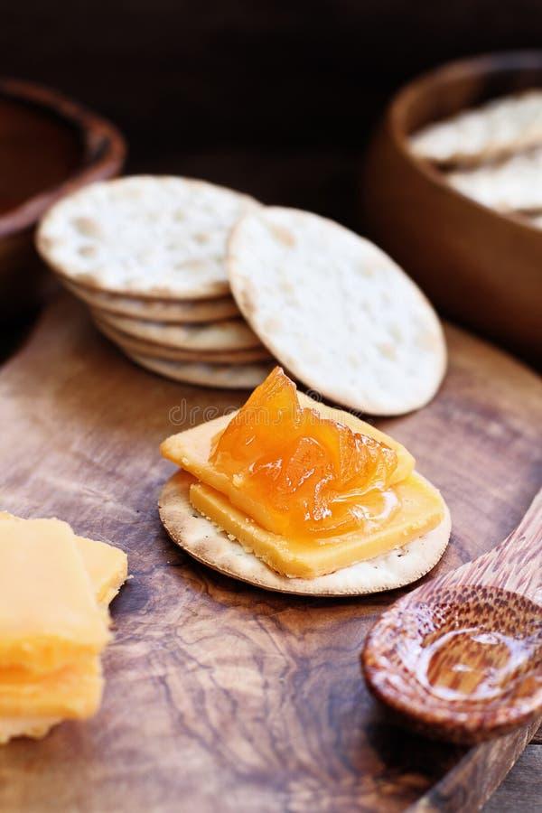Kantalupen-Marmelade und Cheddar-Käse-Aperitif stockfotos