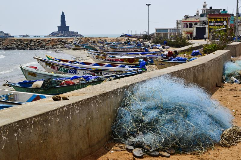 Fishermen boats in a small harbour. Heap of fishing net equipment on the beach. royalty free stock images