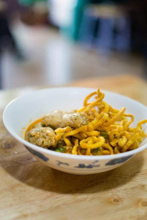 Kao Soi yellow curry noodles. Fresh prepared asian hot Kao Soi yellow curry noodles served with chicken wings. Traditional Chiang Mai thai cuisine made of fresh stock images