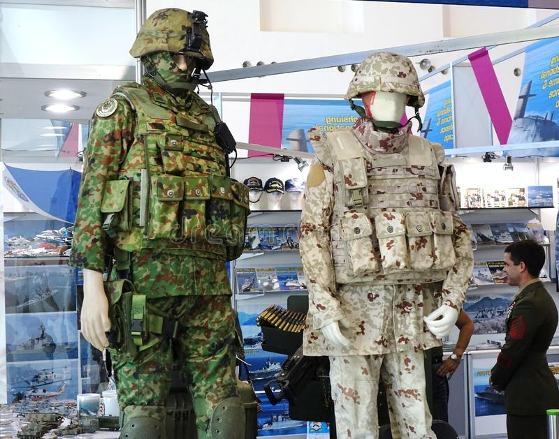 Military Fatigues and Equipment. KAOHSIUNG, TAIWAN -- SEPTEMBER 29, 2018: A trader sells military fatigues at Kaohsiung International Maritime & Defence Expo stock images