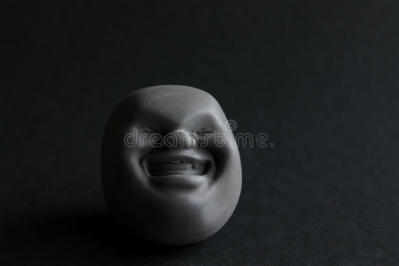 Kaomaro antiesfuerzo del juguete del silicón de la diversión que sorprende en un fondo negro Juguete para el desarrollo de las ha fotos de archivo