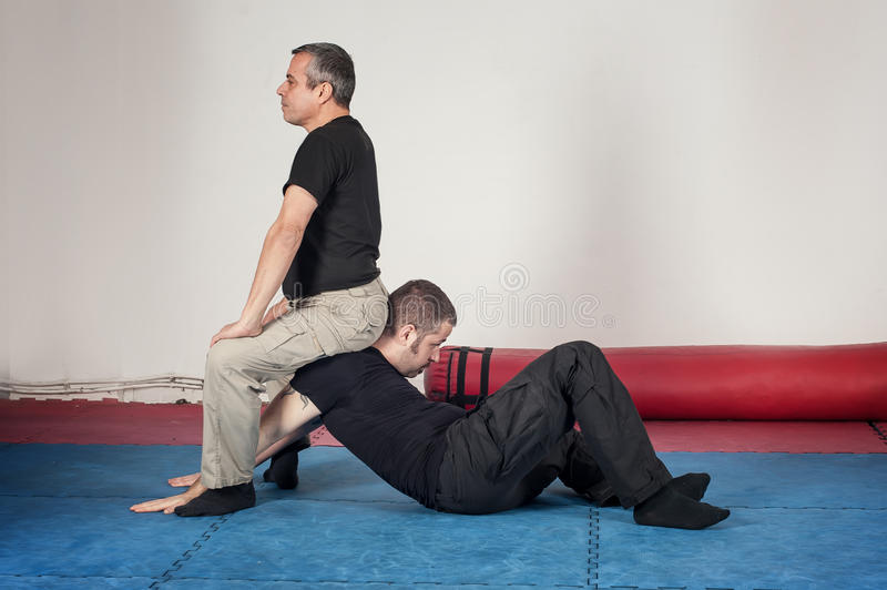 Kapap instructor demonstrates arm lock techniques. With his student royalty free stock photography
