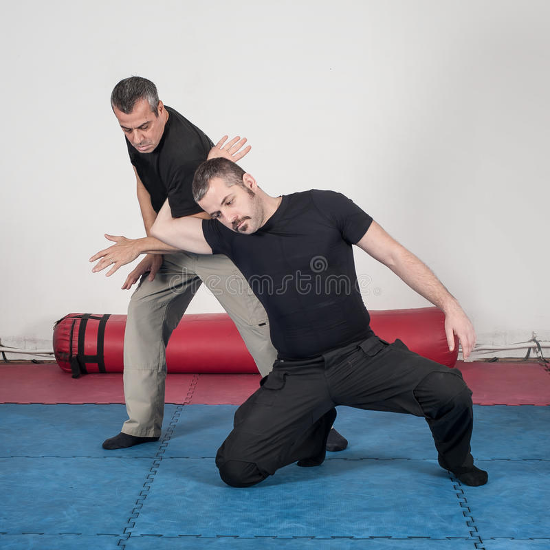 Kapap instructor demonstrates arm lock techniques. With his student royalty free stock photo