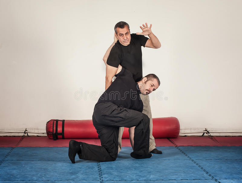 Kapap instructor demonstrates standing arm lock techniques. With his student royalty free stock image