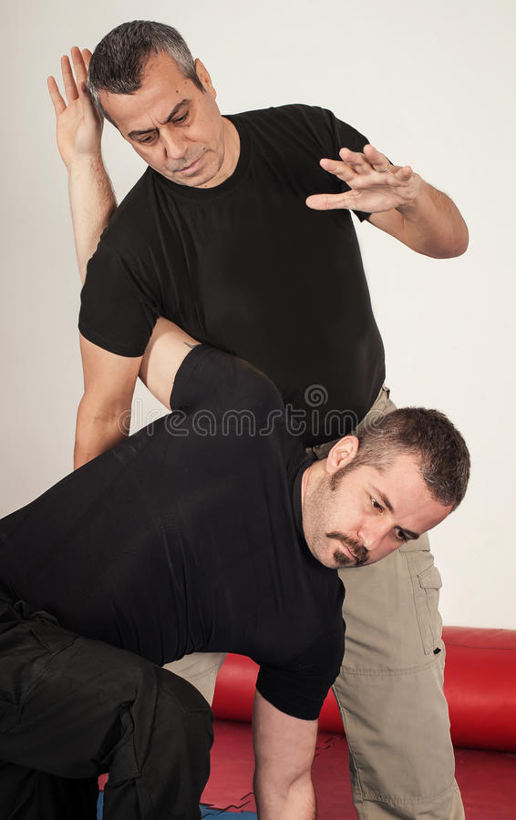 Kapap instructor demonstrates standing arm lock techniques. With his student royalty free stock photography