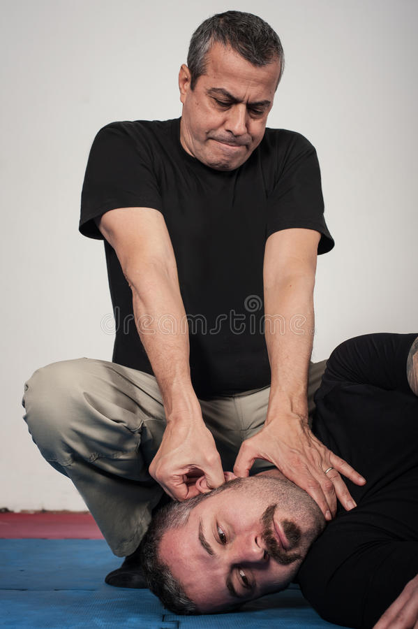 Kapap instructor shows the critical points pressure points figh download kapap instructor shows the critical points pressure points figh stock image image of ccuart Images