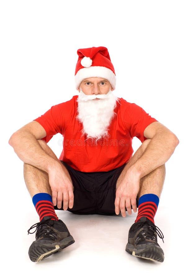 kapeluszowy mężczyzna Santa obsiadanie obraz stock