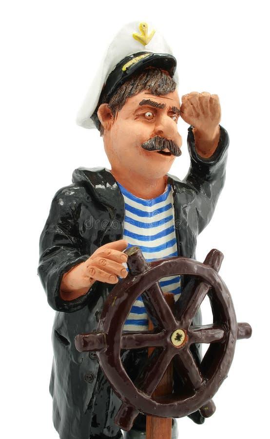 Kapitän mit dem Steuerungrad getrennt worden lizenzfreies stockfoto