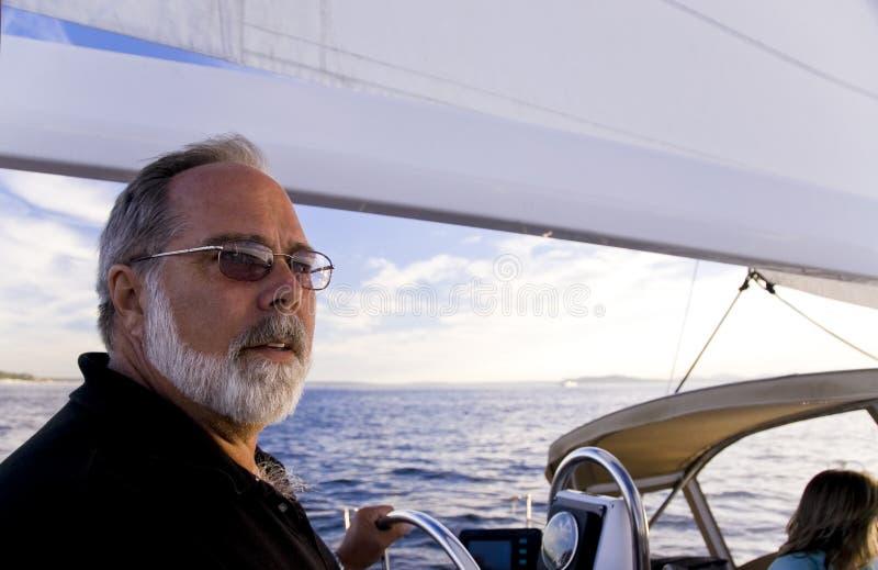 Kapitein bij het Wiel stock afbeeldingen