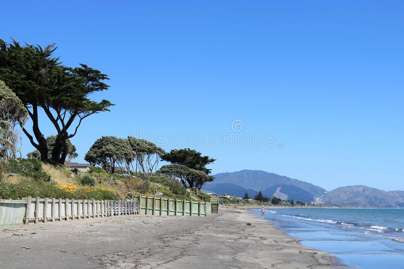 Kapiti Coast shoreline, North Island, New Zealand. View along the shoreline of the Kapiti Coast between Paraparaumu and Raumati Beach on North Island, New royalty free stock images