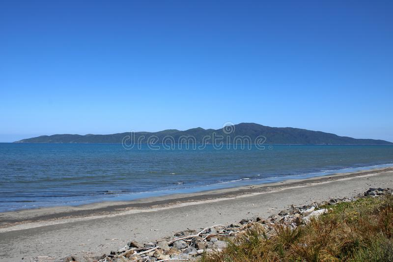 Kapiti Island from Paraparaumu Beach, New Zealand. Looking north west from Paraparaumu Beach on the Kapiti Coast of North Island, New Zealand to Kapiti Island on stock photo