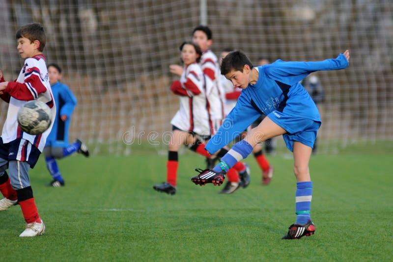Kaposvar - het voetbalspel van Pecs U13 stock afbeelding
